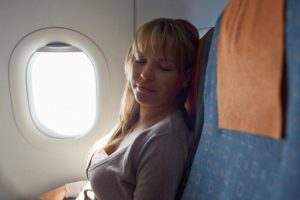 people-travelling-relaxed-woman-sleeping-on-plane